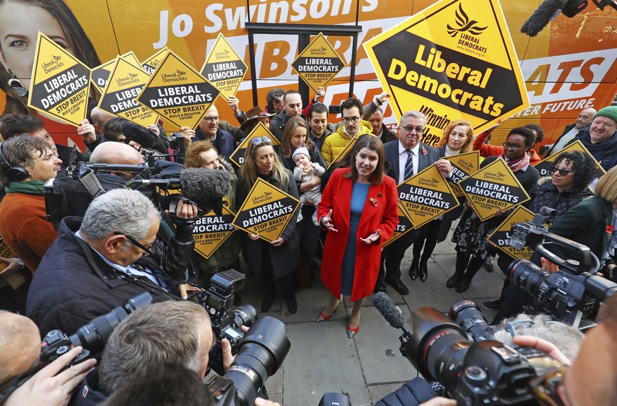 Britain's Liberal Democrat leader Jo Swinson, center, on the election campaign trail in North London, Wednesday Nov. 6, 2019. Britain's three major national political parties wooed weary voters on Tuesday, all promising an end to Brexit wrangling if they win next month's national election â?? but offering starkly different visions of how to achieve that. (Aaron Chown/PA via AP)