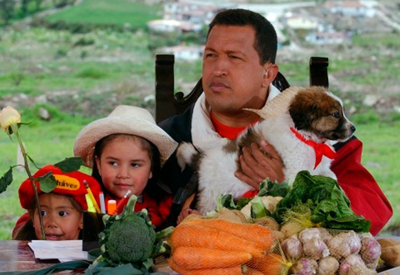 FILE - In this May 18, 2003 file photo released by Miraflores Press Office, Venezuela's President Hugo Chavez holds a mucuchies pup during his radio and television show
