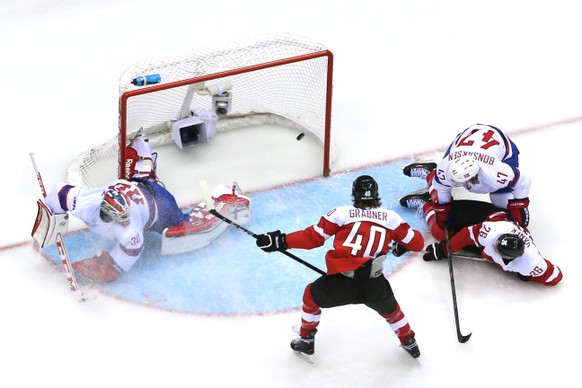SOCHI, RUSSIA - FEBRUARY 16:  Michael Rene Grabner #40 of Austria scores a goal in the first period against Lars Haugen #30 of Norway during the Men's Ice Hockey Preliminary Round Group B game on day nine of the Sochi 2014 Winter Olympics at Bolshoy Ice Dome on February 16, 2014 in Sochi, Russia.  (Photo by Bruce Bennett/Getty Images)