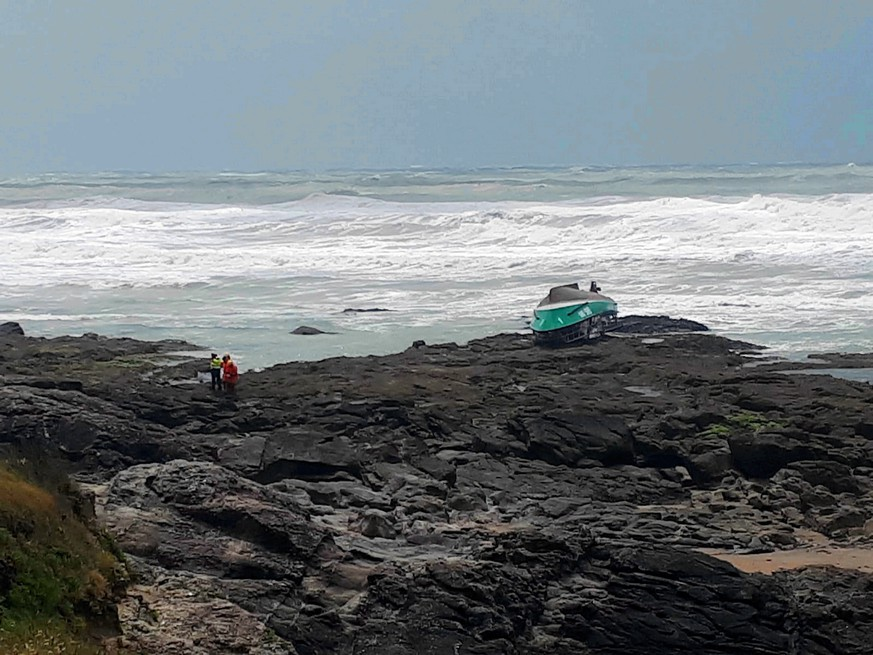 epa07633056 A general view on an overturned boat of a National Society of Sea Rescue rescue boat at the beach of Les Sables d'Olonne, France, 07 June 2019. Three crew members of the rescue boat died during rough seas caused by sotrm Miguel.  EPA/Gregory Jullian/France-Bleu Loire Ocean SHUTTERSTOCK OUT, FRANCE OUT, NO MAGAZINES NO MAGAZINES