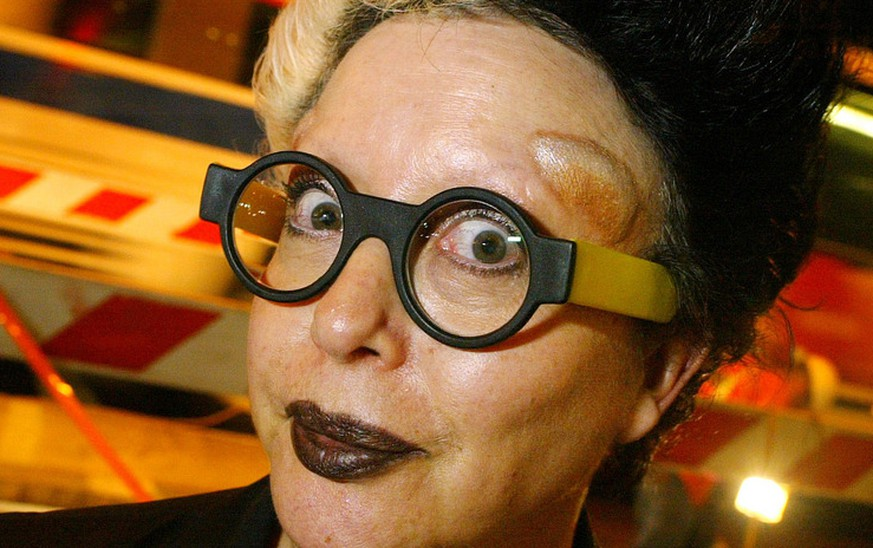 French artist Orlan attends a ceremony as she is awarded the Order of Merit by French Culture Minister Frederic Mitterand, unseen, in Paris, Wednesday, Sept. 8, 2010. (AP Photo/Christophe Ena)