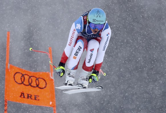 Switzerland's Wendy Holdener speeds down the course during the downhill portion of the women's combined, at the alpine ski World Championships in Are, Sweden, Friday, Feb. 8, 2019. (AP Photo/Marco Trovati)