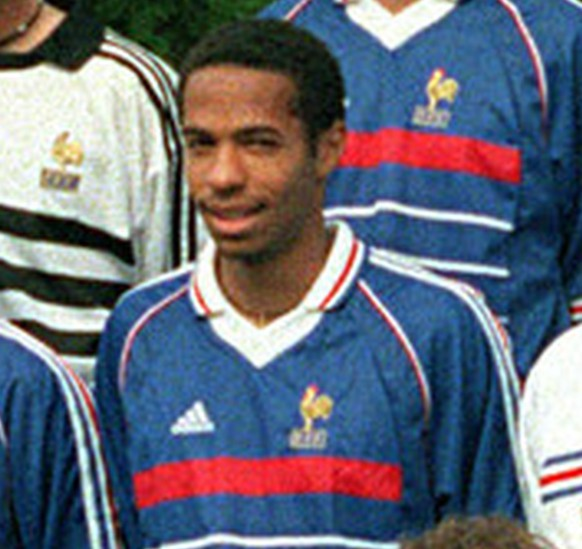 The French socecr team poses for the traditional official photo ahead of the World Cup at Clairefontaine, south of Paris Tuesday June 2, 1998. France will play in Group C with South Africa, Saudi Arabia and Denmark. Front row, from left: Bernard Diomede, Christophe Dugarry, Marcel Desailly, Lionel Charbonnier, Alain Boghossian, Frank Leboeuf, Bixente Lizarazu, Didier Deschamps. Second row, from left: unidentified aide, Christian Karembeu, Emmanuel Petit, Thierry Henry, coach Aime Jacquet, Robert Pires, David Trezeguet, Vincent Candela, Youri Djorkaeff, unidentified aide. Third row from left: Lilian Thuram, Fabien Barthez, Stephane Guivarch, unidentified, Zinedine Zidane, Laurent Blanc, Bernard Lama, Patrick Vieira. (AP Photo/Michel Lipchitz)