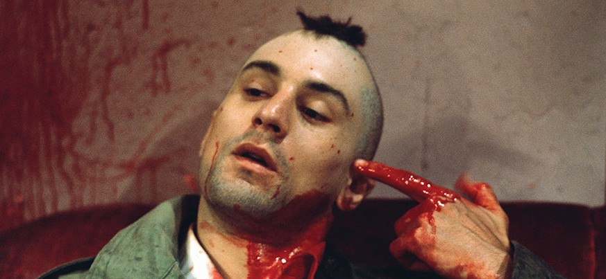 1976 --- Robert De Niro as Travis Bickle points a bloody finger at his head in a suicidal gesture on the set of Martin Scorsese's Taxi Driver. --- Image by Steve Schapiro http://www.hollywoodreporter.com/features/taxi-driver-oral-history-de-881032