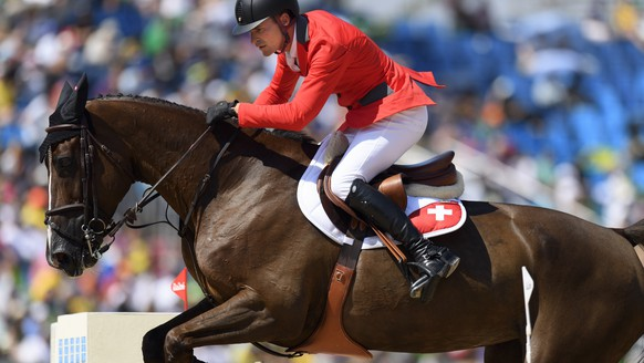 Romain Duguet of Switzerland rides his horse Quorida de Treho during the Equestrian Jumping individual and team qualifier in the Olympic Equestrian Centre in Rio de Janeiro, Brazil, at the Rio 2016 Olympic Summer Games, pictured on Tuesday, August 16, 2016. (KEYSTONE/Laurent Gillieron)