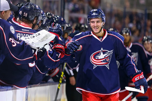Oct 13, 2016; Columbus, OH, USA; Columbus Blue Jackets center Alexander Wennberg (10) celebrates with teammates on the bench after scoring a goal against the Boston Bruins in the first period at Nationwide Arena. Mandatory Credit: Aaron Doster-USA TODAY Sports