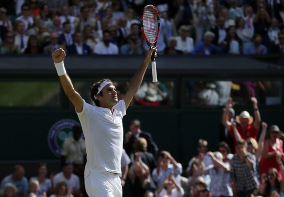 Roger Federer of Switzerland celebrates at match point after beating Marin Cilic of Croatia in their men's singles match on day ten of the Wimbledon Tennis Championships in London, Wednesday, July 6, 2016. (AP Photo/Tim Ireland)