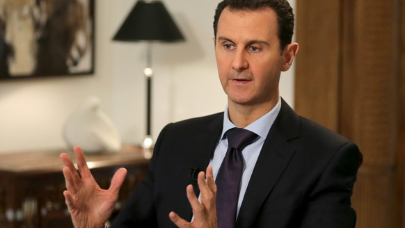 epa05158104 A handout photograph released on 13 February 2016 by the official Syrian Arab News Agency (SANA) shows Syrian President Bashar Assad giving an interview to the AFP news agency, in Damascus, Syria, 11 February 2016. According to SANA, Assad said during the interview that humanitarian problem of Syrian refugees and people inside the country 'is caused by terrorism, Western policies, and the embargo imposed on the Syrian people'.  EPA/SANA HANDOUT  HANDOUT EDITORIAL USE ONLY/NO SALES
