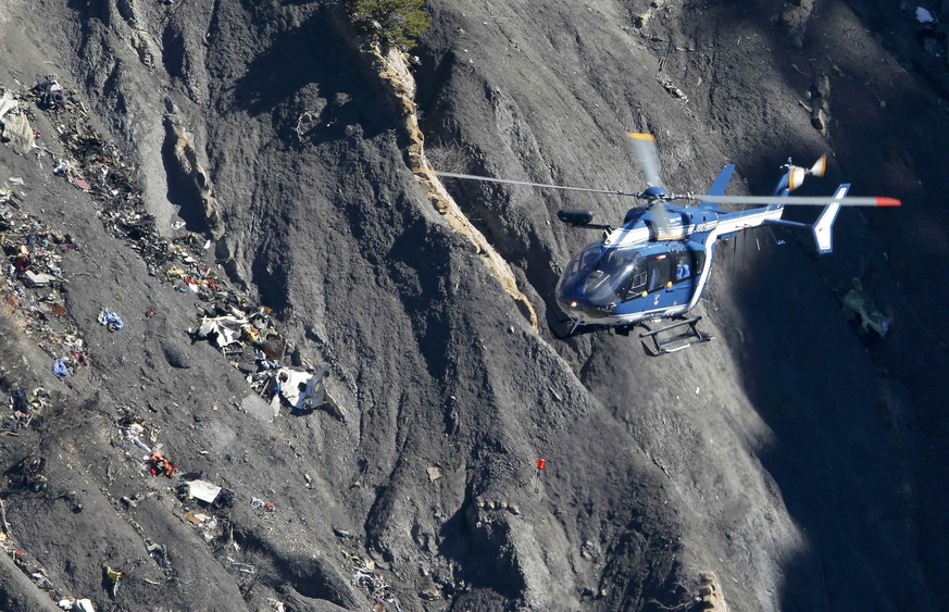 A French Gendarmerie rescue helicopter flies over the debris of the Germanwings Airbus A320 at the site of the crash, near Seyne-les-Alpes, France, in this picture taken on March 27, 2015. French BEA  air accident investigators reported March 13, 2016 that a doctor had recommended that the German pilot who crashed a Germanwings jet into the Alps last year should be treated in a psychiatric hospital two weeks before the disaster. Prosecutors believe co-pilot Andreas Lubitz, who had a history of severe depression, barricaded himself into the cockpit and deliberately propelled his Airbus jet into a mountainside killing all 150 people on board.  Picture taken March 27, 2015.     REUTERS/Gonzalo Fuentes/Files