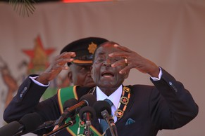 Zimbabwean President Robert Mugabe delivers his speech during the country's 34th independence celebrations at the National Sports Stadium in Harare, Friday, April, 18, 2014. Zimbabwe attained its independence on April 18, 1980 after a  prolonged rule by the British Government. Thousands of people thronged the stadium in the capital to celebrate 34 years of independence.(AP Photo/Tsvangirayi Mukwazhi)