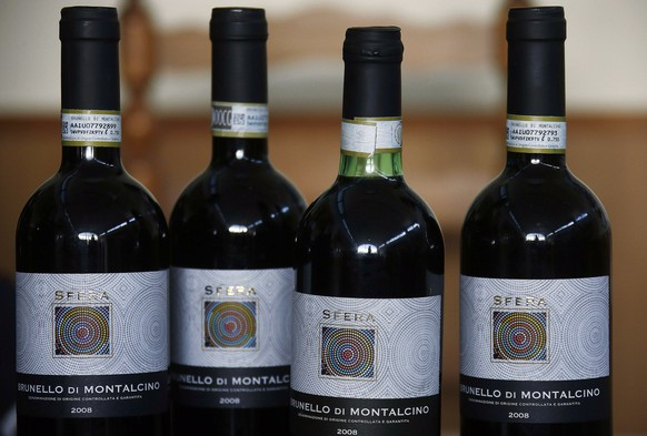 Bottles of wine falsely labeled as prized Brunello di Montalcino are displayed during a press conference in Siena, Italy, Thursday, May 29, 2014. Italian police have seized about 30,000 bottles of wine falsely labeled as prized Brunello di Montalcino, Chianti Classico and other premium wines. Siena Carabinieri Col. Marco Grandini said investigators were alerted to the fraud by consumers who recognized the impostors as