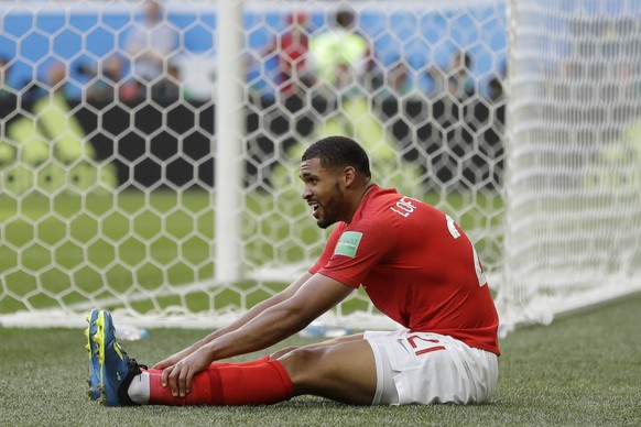 England's Ruben Loftus-Cheek sits on the ground during the third place match between England and Belgium at the 2018 soccer World Cup in the St. Petersburg Stadium in St. Petersburg, Russia, Saturday, July 14, 2018. (AP Photo/Natacha Pisarenko)