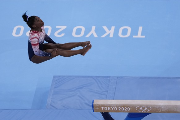 Simone Biles, of the United States, warms up before the artistic gymnastics balance beam final at the 2020 Summer Olympics, Tuesday, Aug. 3, 2021, in Tokyo, Japan. (AP Photo/Morry Gash)