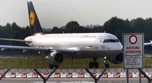 A German airline Lufthansa aircraft is pictured at Munich's airport September 19, 2014. Lufthansa pilots will strike September 30, 2014, after talks over an early retirement scheme broke down again, taking out long-haul flights from Frankfurt between 0600 and 2100 GMT. The Vereinigung Cockpit (VC) trade union said on Monday that Airbus A380, A330 and A340 and Boeing B747 aircraft would not fly from Frankfurt. A spokesman for the union estimated that 70 to 80 flights would be affected. Lufthansa had no immediate comment. Picture taken September 19. 
