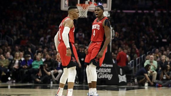 Houston Rockets' Russell Westbrook, left, celebrates with Danuel House Jr. (4) after Westbrook scored during the second half of the team's NBA basketball game against the Los Angeles Clippers on Thursday, Dec. 19, 2019, in Los Angeles. (AP Photo/Marcio Jose Sanchez)Russell Westbrook,Danuel House Jr.