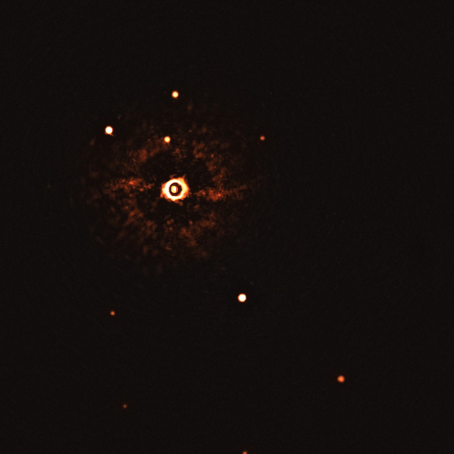 epa08560401 An undated handout photo made available by the European Southern Observatory (ESO) shows star TYC 8998-760-1 accompanied by two giant exoplanets, TYC 8998-760-1b and TYC 8998-760-1c in the image captured by the SPHERE instrument on ESO?s Very Large Telescope (issued 22 July 2020). This is the first time astronomers have directly observed more than one planet orbiting a star similar to the Sun. The image was captured by blocking the light from the young, Sun-like star (on the top left corner) using a coronagraph, which allows for the fainter planets to be detected. The bright and dark rings we see on the star?s image are optical artefacts. The two planets are visible as two bright dots in the centre and bottom right of the frame.  EPA/ESO/Bohn et al. HANDOUT  HANDOUT EDITORIAL USE ONLY/NO SALES
