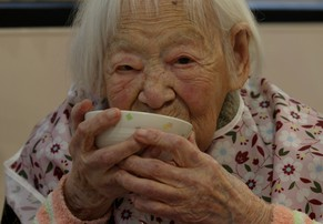 OSAKA, JAPAN - MARCH 05:  Misao Okawa, the world's oldest Japanese woman eats her lunch ahead of her 116th birthday celebrations at Kurenai Nursing Home on March 5, 2014 in Osaka, Japan. Okawa, born in Tenma, Osaka, on March 5, 1898 to a family of Kimono merchants, married in 1919 and had three children, of which a daughter and a son are still alive, and has four grandchildren and six great-grandchildren.  (Photo by Buddhika Weerasinghe/Getty Images)