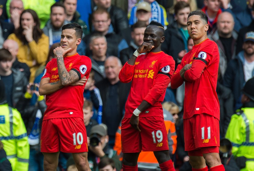 epa05882495 Liverpool's Philippe Coutinho (L) celebrates scoring the third goal making the score 2-1 with Roberto Firmino (R) and Sadio Mane (C) during the English Premier League soccer match between Liverpool and Everton at Anfield, Liverpool, Britain, 01 April 2017.  EPA/PETER POWELL EDITORIAL USE ONLY. No use with unauthorized audio, video, data, fixture lists, club/league logos or 'live' services. Online in-match use limited to 75 images, no video emulation. No use in betting, games or single club/league/player publications.