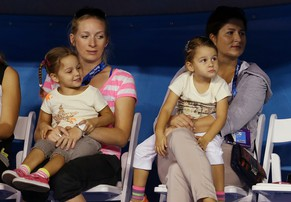 FILE - This Jan. 12, 2013 photo shows Mirka, right, wife of Switzerland's Roger Federer watches with her daughters Myla and Charlene and a unidentified woman during a exhibition match during the Kids Tennis Day at Melbourne Park ahead of the Australian Open tennis championship in Melbourne, Australia. Federer announced on Twitter that he and his wife are expecting another child next year.    (AP Photo/Aaron Favila, File)
