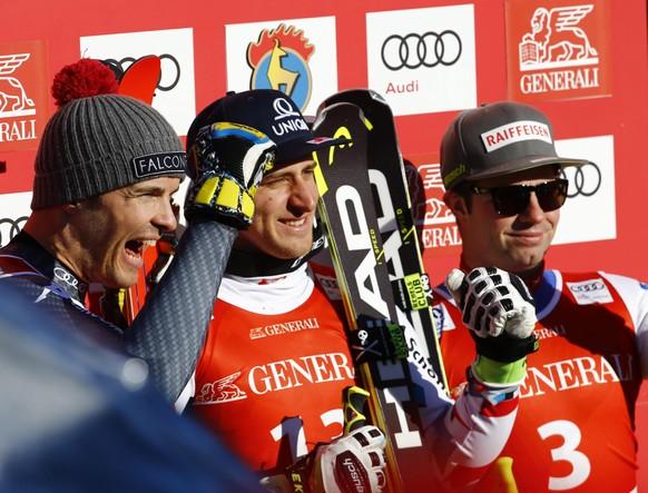 Alpine Skiing - FIS Alpine Skiing World Cup - Men's Super G - Kitzbuehel, Austria - 20/01/17 - Christof Innerhofer of Italy, Matthias Mayer of Austria and Beat Feuz of Switzerland pose at the finish line. REUTERS/Leonhard Foeger