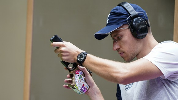 Jean Quiquampoix, of France, competes in the men's 25-meter rapid fire pistol at the Asaka Shooting Range in the 2020 Summer Olympics, Sunday, Aug. 1, 2021, in Tokyo, Japan. (AP Photo/Alex Brandon) Jean Quiquampoix