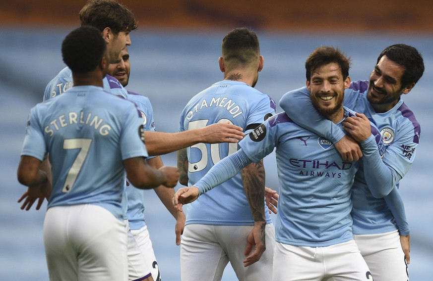 epa08535052 David Silva (2-R) of Manchester City celebrates with teammates after scoring the 4-0 lead during the English Premier League soccer match between Manchester City and Newcastle United in Manchester, Britain, 08 July 2020.  EPA/Oli Scarff/NMC/Pool EDITORIAL USE ONLY. No use with unauthorized audio, video, data, fixture lists, club/league logos or 'live' services. Online in-match use limited to 120 images, no video emulation. No use in betting, games or single club/league/player publications.