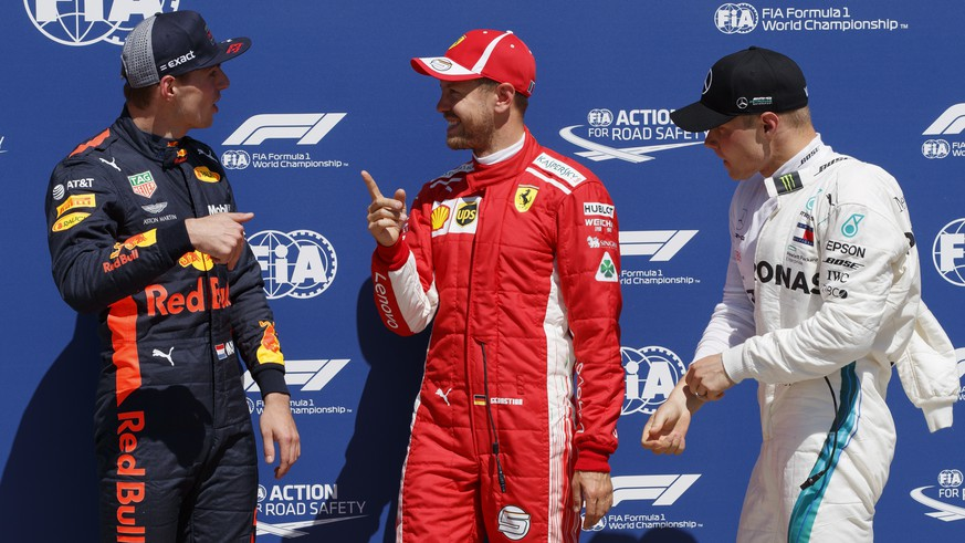epa06797500 German Formula One driver Sebastian Vettel of Scuderia Ferrari (C), Finnish Formula One driver Valtteri Bottas of Mercedes AMG GP (R) and Dutch Formula One driver Max Verstappen of Aston Martin Red Bull Racing (L) react after the qualifying session at the Gilles Villeneuve circuit in Montreal, Canada, 09 June 2018. Sebastian Vettel took pole position while Valtteri Bottas second and Max Verstappen third. The 2018 Canada Formula One Grand Prix will take place on 10 June.  EPA/VALDRIN XHEMAJ