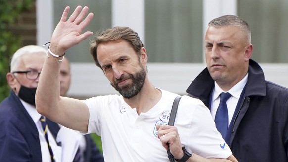 England manager waves Gareth Southgate as he leaves the Grove Hotel, Hertfordshire, England Monday July 12, 2021 the day after Italy beat England 3-2 on penalties to win the Euro 2020 final at Wembley. ( Jonathan Brady/PA via AP)
