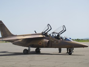 This photo taken on June 18, 2014 in Garoua, northern Cameroon, shows a Cameroon's Air Force Alpha Jet parked following a surveillance flight over the northern border, as part of a reinforcement of its military action against Nigerian Islamist group Boko Haram. Boko Haram, which in April 2014 kidnapped more than 200 schoolgirls in northeast Nigeria to international condemnation, has been waging a brutal, five-year insurgency that has claimed thousands of lives. AFP PHOTO / REINNIER KAZE