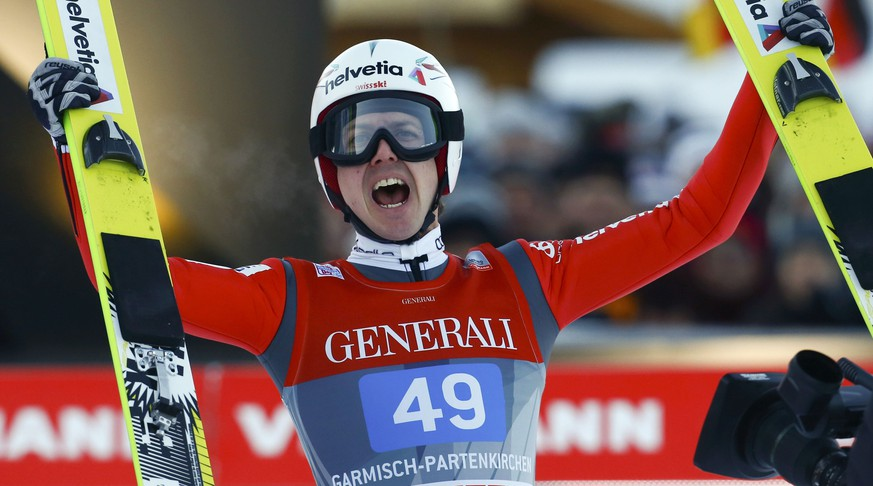Simon Ammann from Switzerland reacts after placing second in the second jumping of the 63rd four-hills tournament in Garmisch-Partenkirchen, southern Germany, January 1, 2015. The prestigious four-hills tournament will end in Bischofshofen on January 6.    REUTERS/Michael Dalder (GERMANY  - Tags: SPORT SKIING)