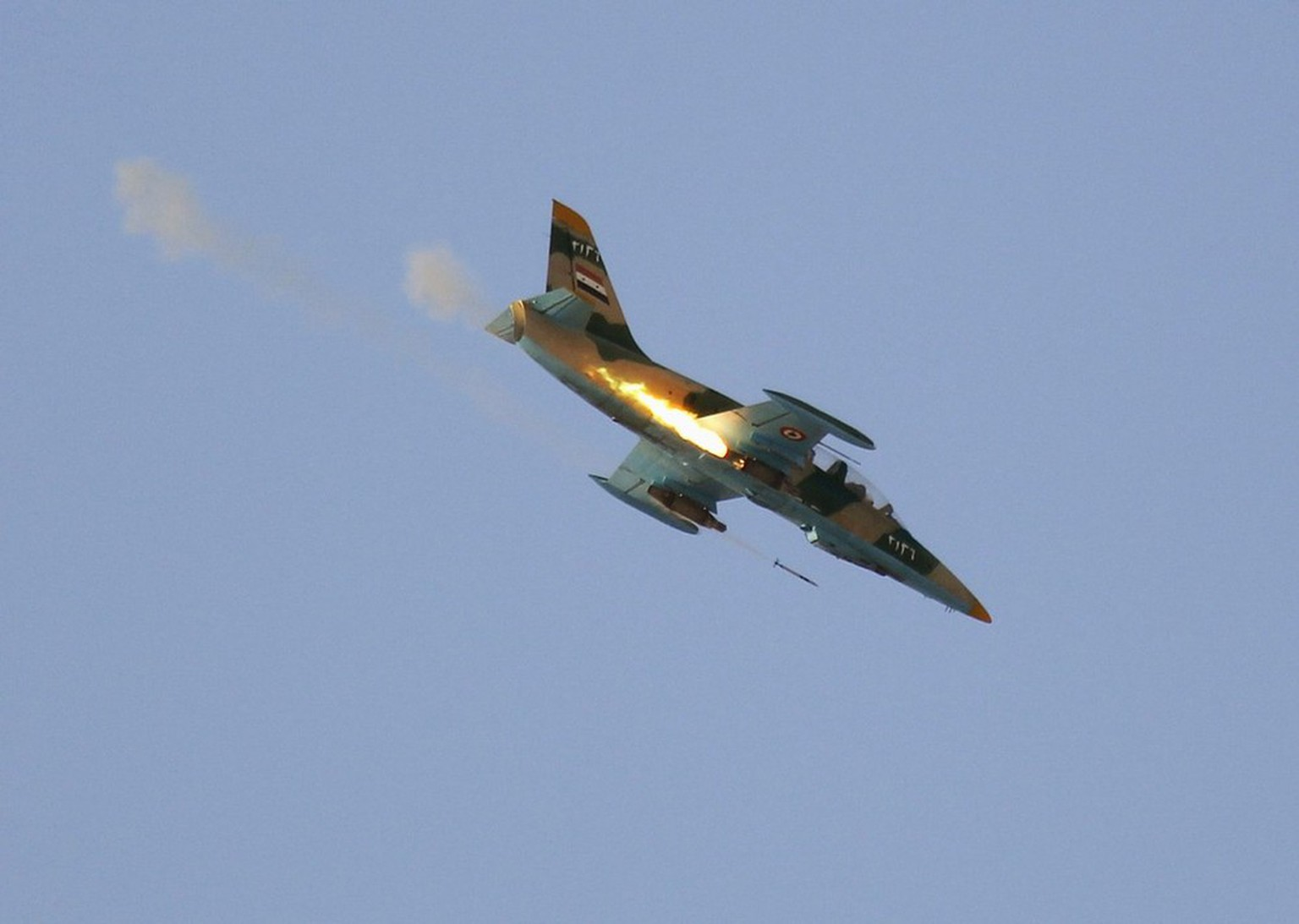 A Syrian Air Force fighter plane fires a rocket during an air strike in the village of Tel Rafat, some 37 km (23 miles) north of Aleppo, August 9, 2012. Syrian troops and rebels fought over the country's biggest city Aleppo as President Bashar al-Assad's key foreign backer Iran gathered ministers from like-minded states for talks on Thursday about how to end the conflict. REUTERS/Goran Tomasevic (SYRIA - Tags: MILITARY CIVIL UNREST TPX IMAGES OF THE DAY)