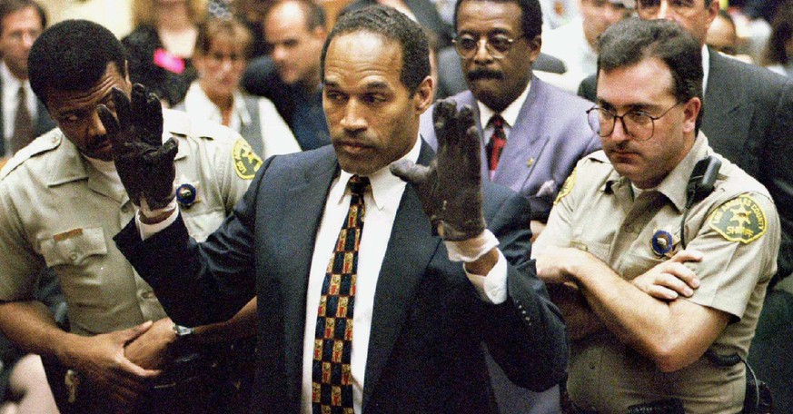 O.J. Simpson holds up his hands to the jury showing leather gloves that prosecutors say he wore the night of the murders of his ex-wife Nicole Brown Simpson and Ron Goldman during the Simpson double-murder trial in Los Angeles, California in this June 15, 1995 file photo. Police in Los Angeles are testing a knife recovered on a property once owned by O.J. Simpson, who was acquitted in the murder of his former wife and her friend, the Los Angeles Police Department said on March 4, 2016.   REUTERS/Sam Mircovich/Files