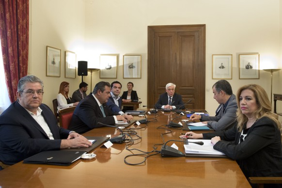 """From left to right, General Secretary of the Greek Communist Party Dimitris Koutsoubas, leader of Independent Greeks party Panos Kammenos, Prime Minister Alexis Tsipras and Greek President Prokopis Pavlopoulos, Potami party Stavros Theodorakis and PASOK Socialist party leader Fofi Gennimata attend a meeting of political party leaders  in Athens, on Monday, July 6, 2015. Greece's finance minister has resigned following Sunday's referendum in which the majority of voters said """"no"""" to more austerity measures in exchange for another financial bailout. (AP Photo/Petros Giannakouris)"""