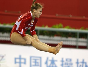 epa04432422 Giulia Steingruber of Switzerland competes on the floor during the Women's All-Around Artistic Gymnastics qualification at the 45th FIG Artistic Gymnastics World Championships in Nanning, China, 05 October 2014.  EPA/RUNGROJ YONGRIT