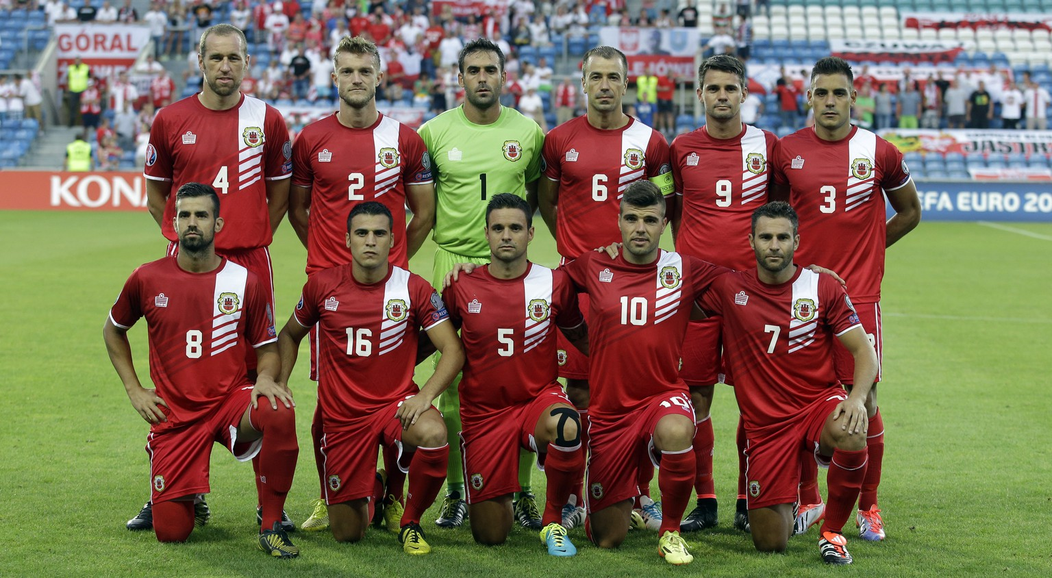 Gibraltar's players David Artell, Scott Wiseman, goalkeeper Jordan Perez, Roy Chipolina, Kyle Casciaro, Joseph Chipolina, upper row from left, and Rafael Bado, Brian Perez, Ryan Casciaro, Liam Walker, Lee Casciaro, lower row from left, pose for the photographers prior an Euro2016 Group D qualifying round soccer match between Gibraltar and Poland at the Algarve stadium in Faro, southern Portugal, Sunday, Sept. 7, 2014. Poland defeated Gibraltar 7-0. (AP Photo/Francisco Seco)
