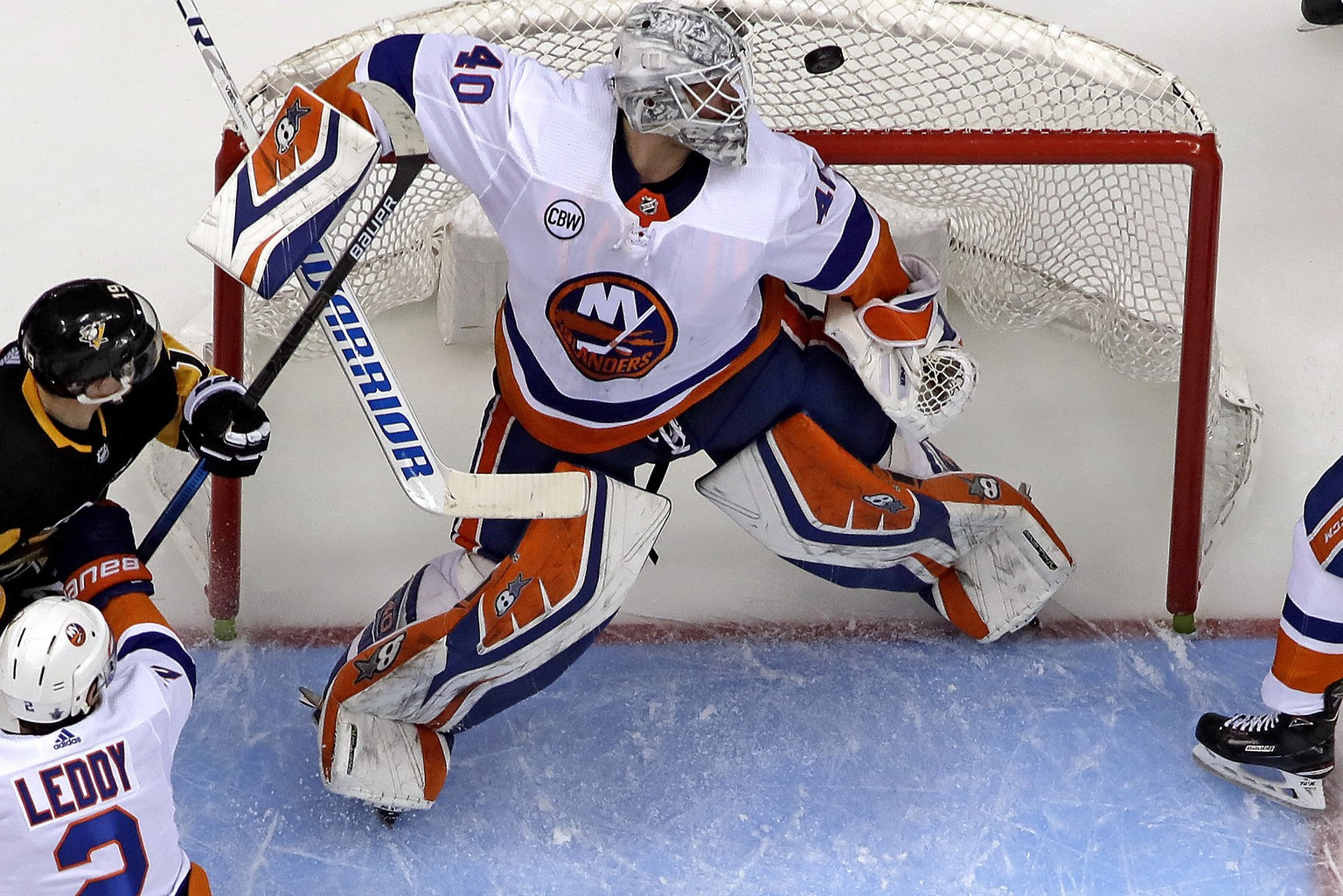 New York Islanders goaltender Robin Lehner (40) watches the puck during the second period in Game 3 of an NHL first-round hockey playoff series against the Pittsburgh Penguins in Pittsburgh, Sunday, April 14, 2019. (AP Photo/Gene J. Puskar)