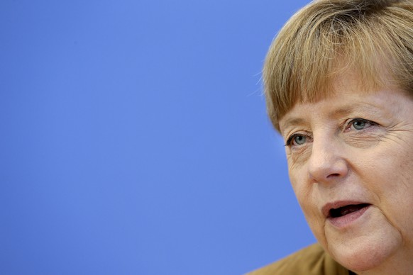 German Chancellor Angela Merkel addresses the media during her annual summer press conference in Berlin, Germany, Friday, July 18, 2014. (AP Photo/Michael Sohn)