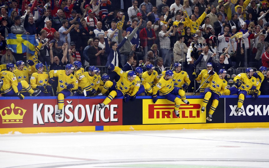 Sweden players celebrate their victory in the Ice Hockey World Championships final match between Canada and Sweden in the LANXESS arena in Cologne, Germany, Sunday, May 21, 2017. (AP Photo/Petr David Josek)