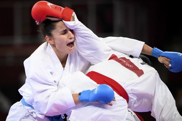 Elena Quirici, left, of Switzerland competes in the women's karate kumite +61kg fight against Feryal Abdelaziz of Egypt at the 2020 Tokyo Summer Olympics in Tokyo, Japan, on Saturday, August 07, 2021. (KEYSTONE/Laurent Gillieron)