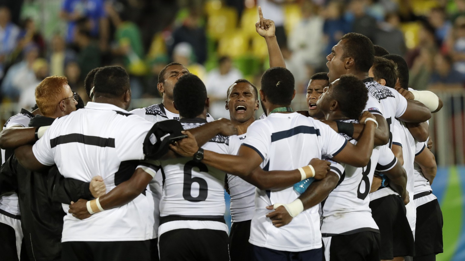 Fiji celebrates its the gold medal victory over Britain in mens rugby sevens at the 2016 Summer Olympics in Rio de Janeiro, Brazil, Thursday, Aug. 11, 2016. (AP Photo/Robert F. Bukaty)