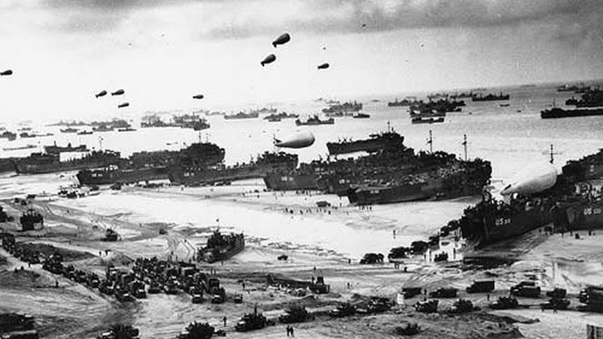 epa07566405 A handout photo made available by the US Army showing US soldiers in cargo vehicles moving onto a beach during the Allied Invasion of Europe, D-Day, in Normandy, France, 06 June 1944. On 06 June 1944, on the first day of Operation Overlord, around 4,300 Allied personnel lost their lives serving their country in what would be the largest amphibious invasion ever launched. World leaders are to attend memorial events in Normandy, France on 06 June 2019 to mark the 75th anniversary of the D-Day landings, which marked the beginning of the end of World War II in Europe.  EPA/US ARMY / HANDOUT MANDATORY CREDIT: US ARMY ATTENTION: This Image is part of a PHOTO SET HANDOUT EDITORIAL USE ONLY/NO SALES