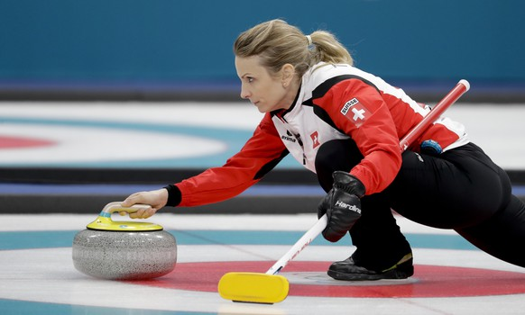 Switzerland's skip Silvana Tirinzoni throws a stone during a women's curling match against United States at the 2018 Winter Olympics in Gangneung, South Korea, Thursday, Feb. 15, 2018. (AP Photo/Natacha Pisarenko)