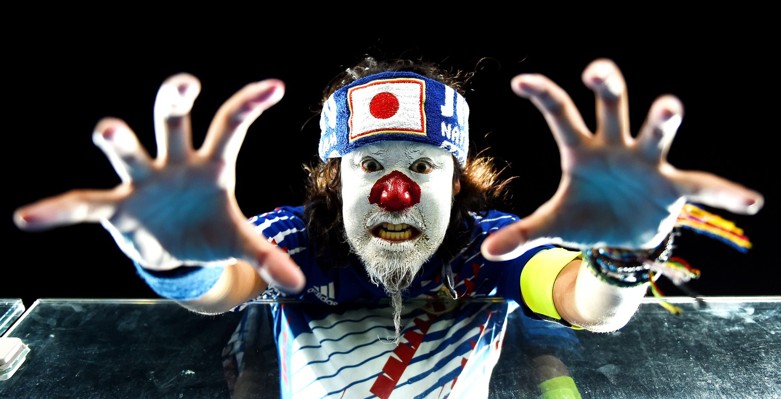 NATAL, BRAZIL - JUNE 19:  A Japan fan shows support prior to the 2014 FIFA World Cup Brazil Group  C match between Japan and Greece at Estadio das Dunas on June 19, 2014 in Natal, Brazil.  (Photo by Laurence Griffiths/Getty Images)