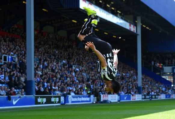 LONDON, ENGLAND - MAY 16:  Emmanuel Riviere of Newcastle United celebrates scoring the opening goal during the Barclays Premier League match between Queens Park Rangers and Newcastle United at Loftus Road on May 16, 2015 in London, England.  (Photo by Shaun Botterill/Getty Images)