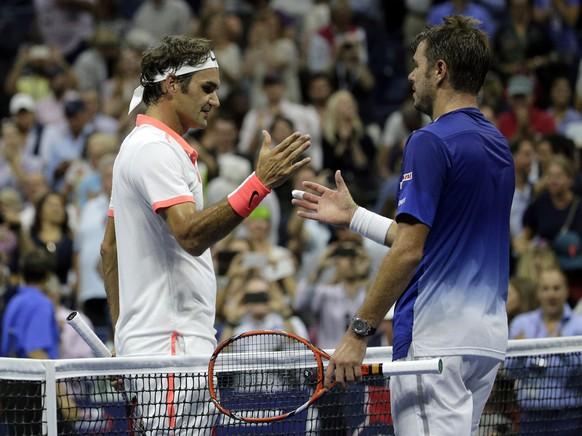 Roger Federer, of Switzerland, left greets Stan Wawrinka, of Switzerland, after winning their semifinal match at the U.S. Open tennis tournament, Friday, Sept. 11, 2015, in New York. (AP Photo/Bill Kostroun)