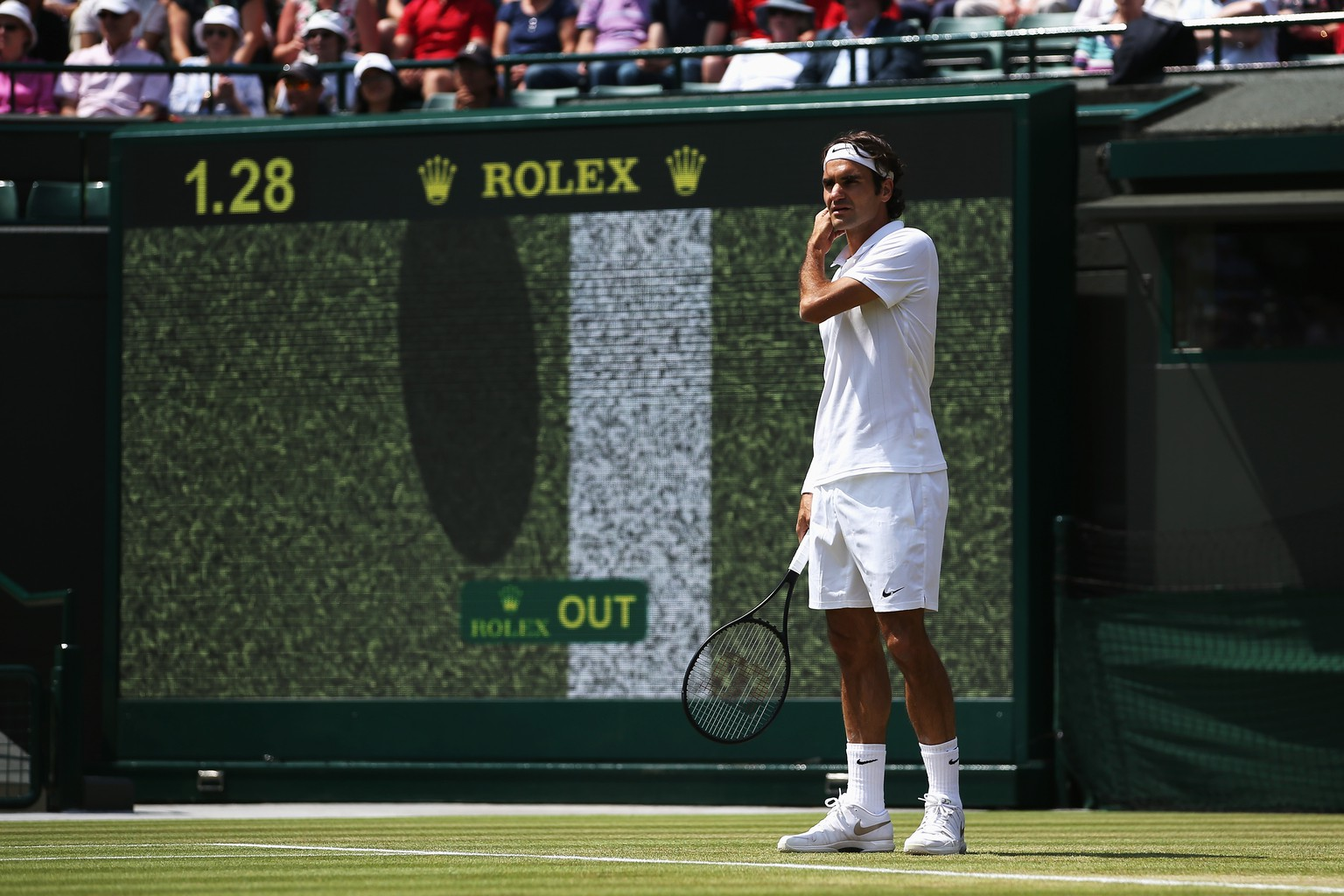 LONDON, ENGLAND - JULY 01:  Roger Federer of Switzerland looks on as a hawk eye review is displayed on screen behind him during his Gentlemen's Singles fourth round match against Tommy Robredo of Spain on day eight of the Wimbledon Lawn Tennis Championships at the All England Lawn Tennis and Croquet Club on July 1, 2014 in London, England.  (Photo by Jan Kruger/Getty Images)