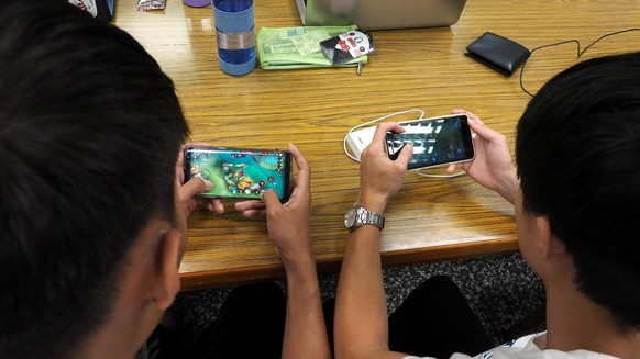 epa06821135 University students play video games on their smartphones in Taipei, Taiwan, 19 June 2018. The World Health Organization (WHO) has defined compulsive video gaming as a mental health condition by adding it to the 11th update of the International Classification of Diseases (ICD), a guide that describes different health problems and their symptoms. 'Gaming disorder' affects millions of people around the world, disrupting their life and causing sleeping and eating disorder, according to reports.  EPA/DAVID CHANG