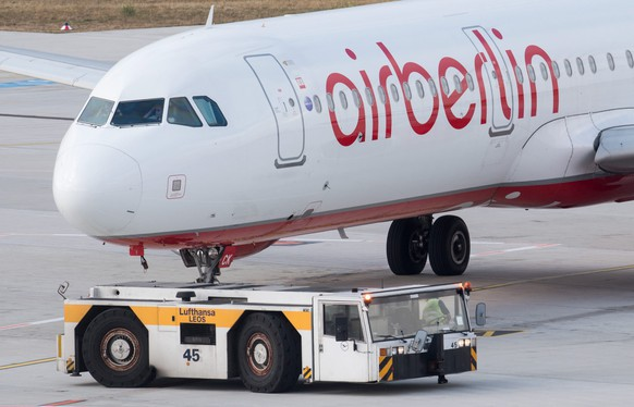 epa05561703 An airplane of German carrier Air Berlin is being pulled by a vehicle of Lufthansa at the airport in Duesseldorf, Germany, 29 September 2016. Air Berlin on 28 September 2016 announced a major restructuring plan which includes giving scores of planes to rival airlines and axing 1,200 jobs.  EPA/BERND THISSEN
