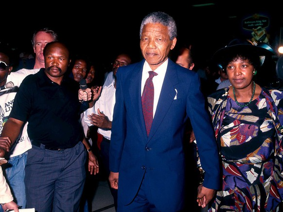 A photo dated 27 February 1990 of former South African President Nelson Mandela and his second wife, Winnie Mandela at Johannesburg International airport, South Africa, before their departure for a trip to Zambia. Thursday 11 February 2010 marks the 20th anniversary of Nelson Mandelas release from prison. On 11 February 1990 a dignified and determined Nelson Mandela walked out of Victor Verster prison in Cape Town South Africa, a free man for the first time in 27 years. When he arrived at the City Hall a crowd of 50,000 supporters had assembled.  From the balcony he spoke his first words in public for over a quarter century. 'Our struggle has reached a decisive moment. Our march to freedom is irreversible.' The event was broadcast live all over the world. The lawyer and anti-apartheid activist had been convicted of treason and sabotage in June 1964 and sentenced to life imprisonment. He spent most of his sentence on Robben Island, off Cape Town, doing hard labour. During the 1980s he refused many offers for early release from the government because of the conditions attached. However, on 02 February 1990, South African President F.W. de Klerk reversed - after long negotiations with Mandela - the ban on the ANC and other anti-apartheid organisations, and announced that Mandela would be released. This was the beginning of the opening up of apartheid-era South Africa where blacks had been severely discriminated against. In the first national elections in which blacks had the right to vote the ANC won and Mandela became President.  He remained in that office from 1994 to 1999. The Opening of Parliament this year has been scheduled to coincide with the 20th anniversary of Mandela's release and South African President Jacob Zuma will honour him in his State of the Nation address.  EPA/STR