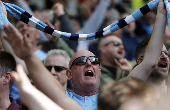 Manchester City fans cheer on the stands before the start of the English Premier League soccer match between Brighton and Manchester City at the AMEX Stadium in Brighton, England, Sunday, May 12, 2019. (AP Photo/Frank Augstein)